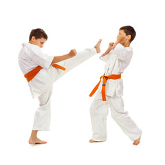 Two boys in white kimono fighting