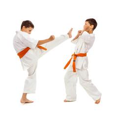Two boys in white kimono fighting