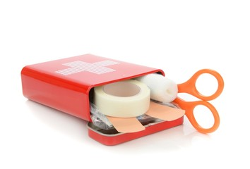 An open travel first aid kit lying on a white background