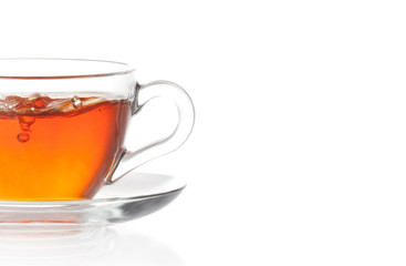 Tea with air bubbles isolated in white