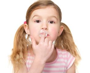 Cute Little Girl Chewing Gum