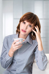a businesswoman drinking coffee at office