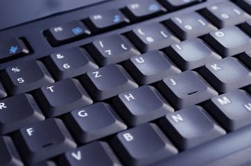 Black keyboard illuminated by screen