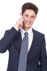 Smiling young executive using cellphone, closeup portrait on whi