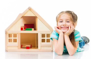 girl with a toy house