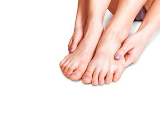 Bare female feet on the white background