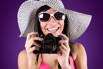 woman with bikini holding vintage retro camera