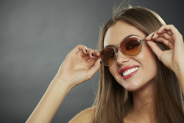 Young chic woman wearing sunglasses and smiling