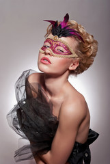 Beautiful woman in Venetian mask