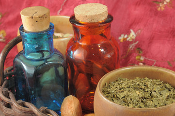 Photo on textile frame Pharmacy Vintage medical bottles and a mix of dry herbs