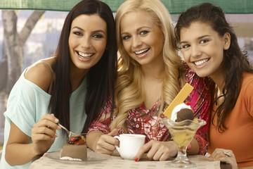 Portrait of three beautiful women smiling