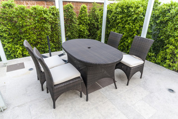 chairs and table near garden - garden furniture