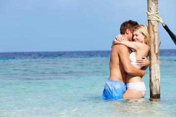 Romantic Couple Standing In Beautiful Tropical Sea
