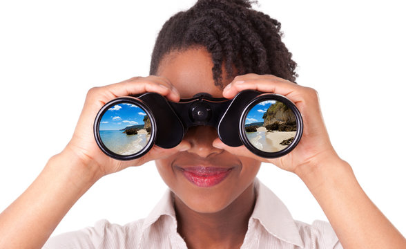 Young black / african american business woman using binoculars l