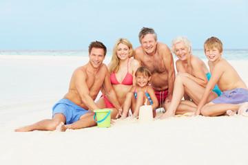Multi Generation Family Having Fun On Beach Holiday