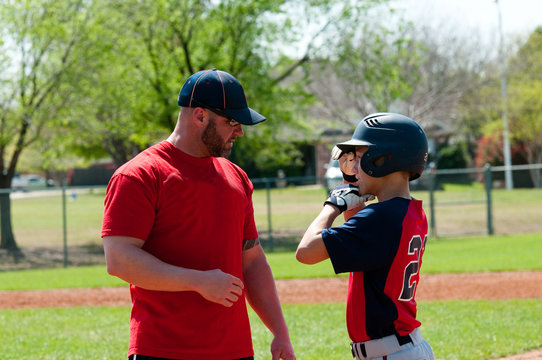 Baseball coach and teen player