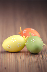 Colorful Easter eggs on wood surface
