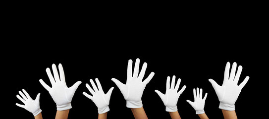 a lot of white hands against black background