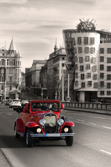 Red beautiful vintage cars in Prague