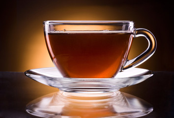 Cup of black tea isolated on a black background