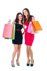 Young attractive girl with shopping bags in hand