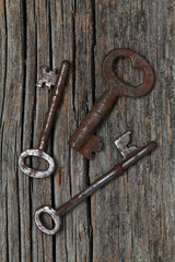 old rustic keys on wooden backround