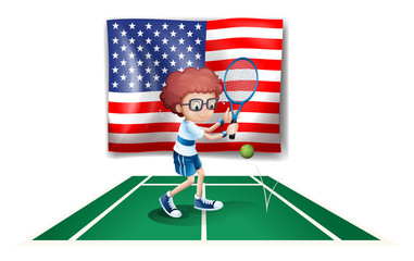 A tennis player in front of the USA flag