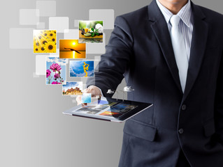 business man shows touch screen tablet with streaming images