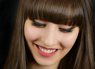 Portrait of a young beautiful woman with bangs in studio