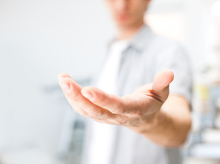 Man holding something on his hand
