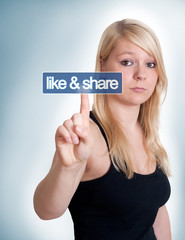woman pressing like and share button