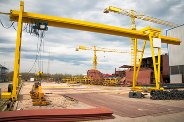 Ship and monumental crane in the shipyard