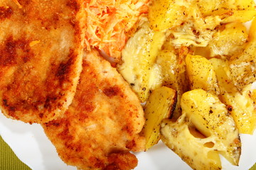 Fried chicken roasted potatos and carrot salad