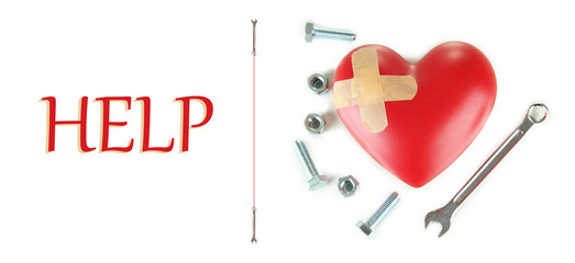 Heart and tools isolated on white. Concept: Renovation of