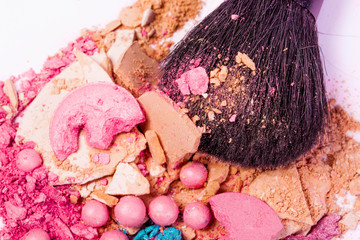 close up of a make up accessories-powder, eyeshadows, lipstick