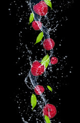 Deurstickers Opspattend water Raspberries in water splash, isolated on black background