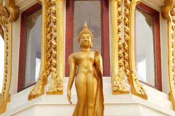 The gold buddha stand image statue