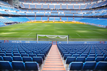 Foto auf Gartenposter Stadion Empty football stadium with blue seats, rolled gates