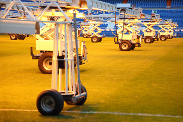 Lighting system for growing grass at empty football stadium