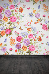 vintage room with floral colorful wallpaper and wooden floor