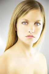 Portrait of beautiful blonde woman with blue eyes