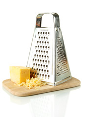 Metal grater and cheese on cutting board, isolated on white