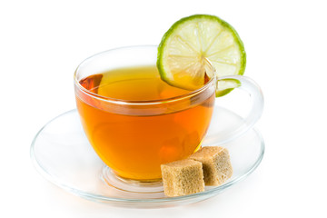Wall Mural - Tea in a glass cup with lime