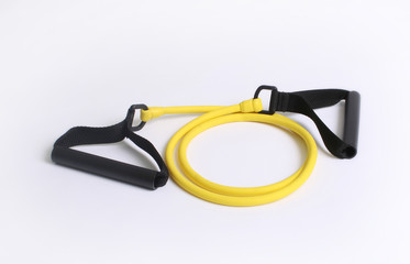 Yellow resistance strength training bands over white background