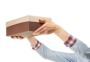 Woman's hands reaches out a cardboard box