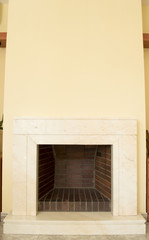 marble fireplace with yellow wall
