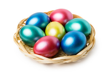 Multi-colored Easter eggs in basket