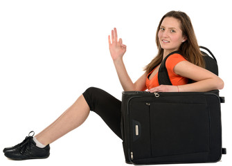 tourist woman with baggage showing sign isolated on white