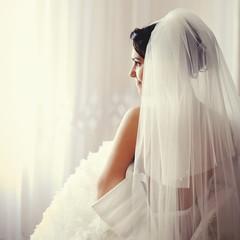 Beautiful Brunette bride is getting ready