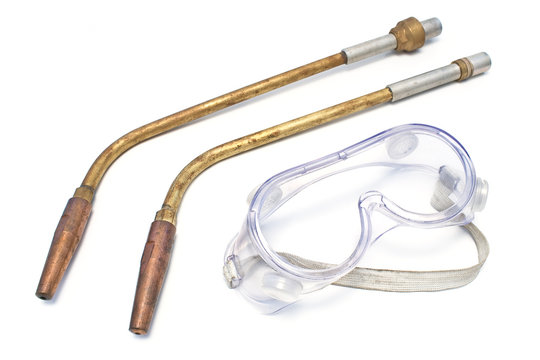 Two nozzles for an autogenous welding with safety glasses